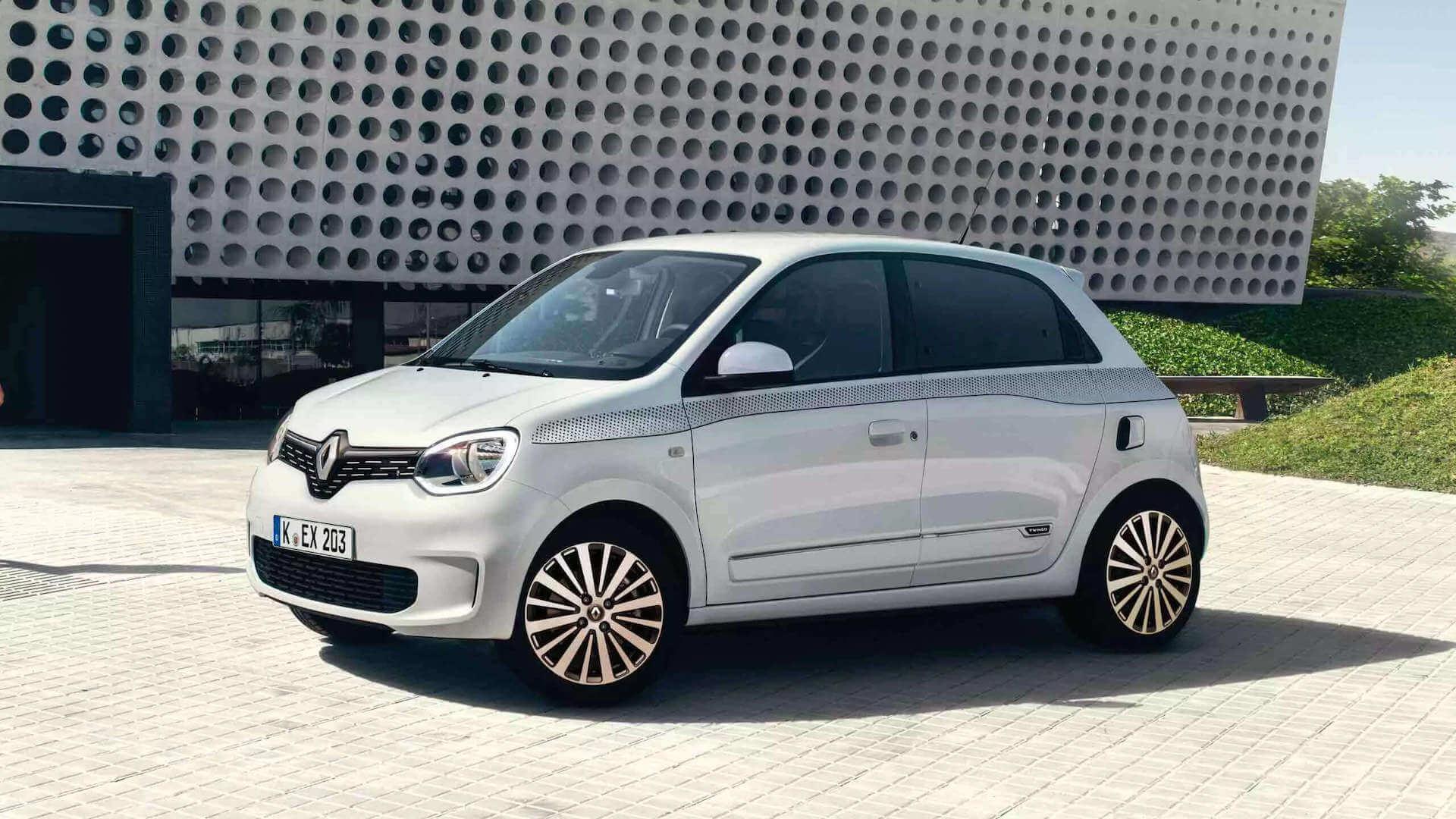 Weißes auto steht vor einem Gebäude - Renault Twingo - Renault Ahrens Hannover