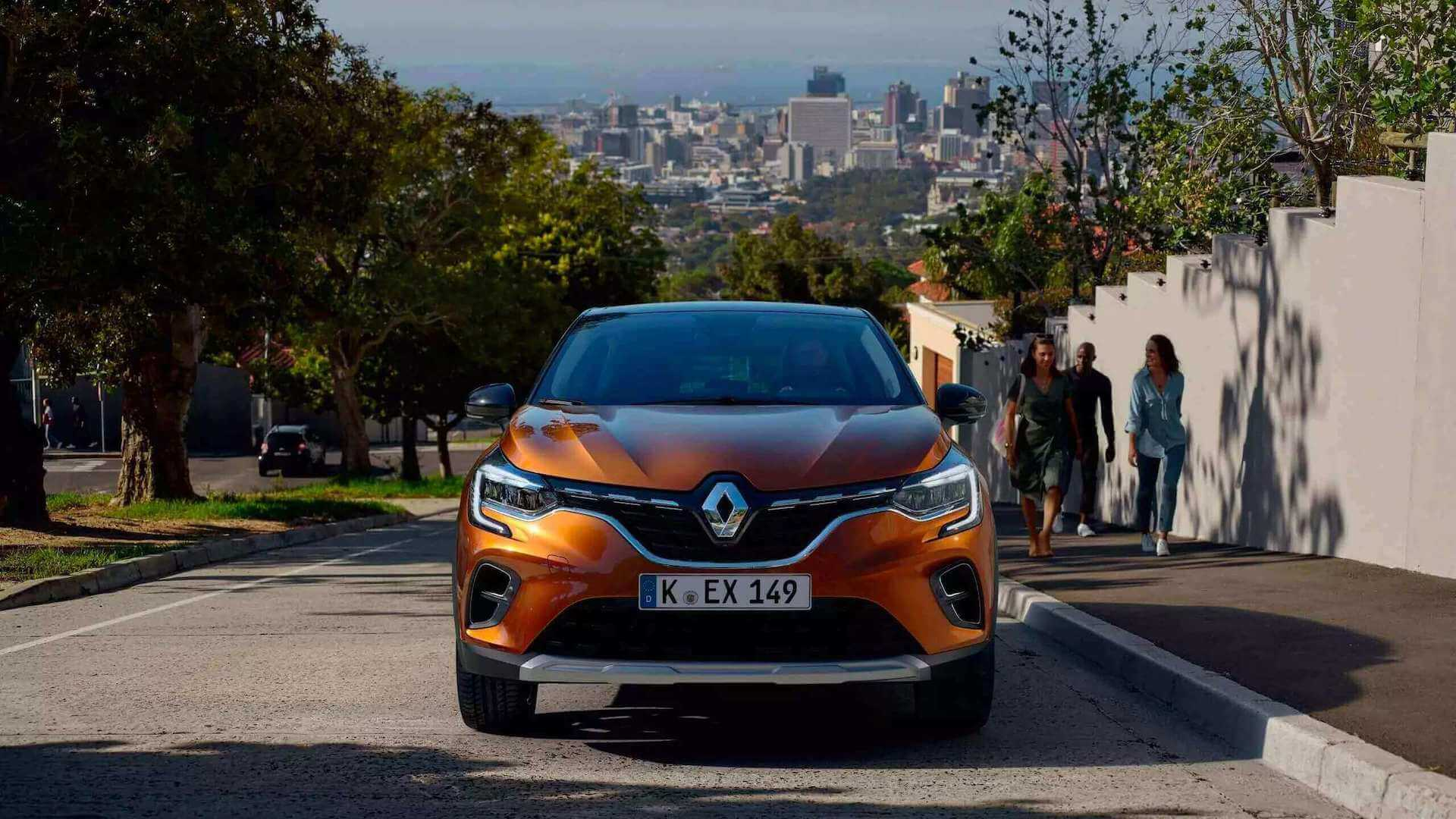 Frontansicht - orangenes Auto auf einer Straße - Renault Captur - Renault Ahrens Hannover